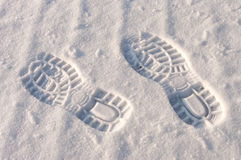 Footprints in snow Stock Images