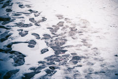 Footprints in snow Stock Photography