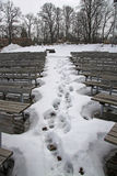 Footprints in the snow between the benches of the amphitheater of Sigulda castle Stock Photo