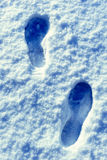 Footprints in snow covered countryside Royalty Free Stock Photo