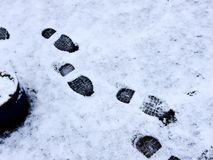 Footprints in the snow. Snow covered lawn with footprints Royalty Free Stock Images