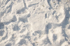 Footprints in the snow. On the ground Royalty Free Stock Photos