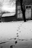 Footprints on the Snow and Home Royalty Free Stock Photo