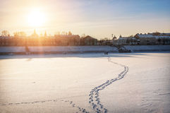 Footprints in the snow. And ice-covered river Stock Image