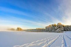 Footprints in the Snow Lake. Stock Photo