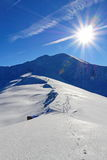 Footprints on the snow. Leadint to the mountain top Stock Image