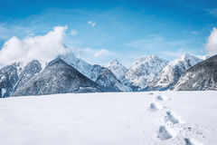 Footprints in the snow in the mountains Royalty Free Stock Image