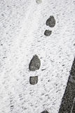 Footprints in snow Stock Image