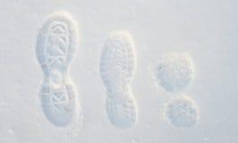 Footprints on the snow Stock Photo