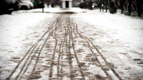 Footprints on the snowy sidewalk Stock Image