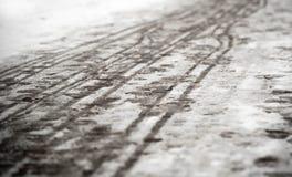 Footprints on the snowy sidewalk Royalty Free Stock Photos