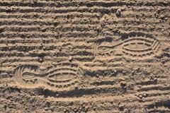 Footprints on soil. Footprints on loosened soil - background Stock Photo