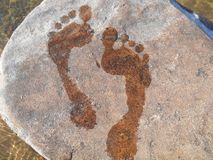 Footprints in stone Royalty Free Stock Photo