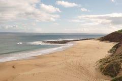 Footprints at surfing beach Royalty Free Stock Photos
