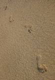 Footprints Textured Sand. Footprints on textured sand Stock Photos