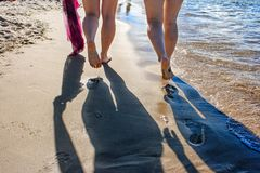 Footprints in the wet sand of the beach. On sunny summer day Royalty Free Stock Photo
