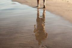 Footprints in wet sand of beach. Walk Royalty Free Stock Image