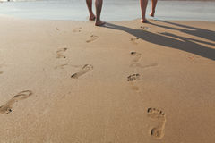 Footprints in wet sand. Of man and a woman Stock Photos