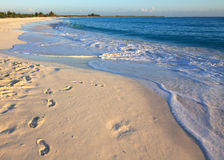 Footprints on the white sand. Royalty Free Stock Images