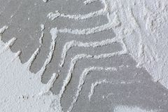 Footprints from workers shoes on the dust from construction on the sheets of plasterboard drywall in room is under construction. Remodeling, renovation Royalty Free Stock Photos