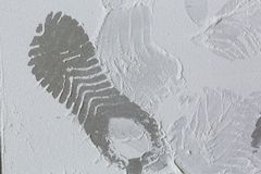 Footprints from workers shoes on the dust from construction on the sheets of plasterboard drywall in room is under construction. Remodeling, renovation Stock Photos