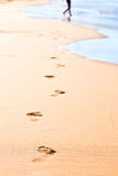 Footprints on yellow sand Royalty Free Stock Images