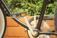 Footrest of bikes parked in the park. Royalty Free Stock Image