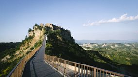 Footridge leading to Civita di Bagnoregio royalty free stock photo