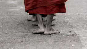 Foots of ascetic Buddhist monk walking at the way to  Kyaikhtiyo Royalty Free Stock Images