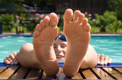 The foots of man in water Royalty Free Stock Photography