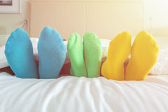 Free Foots Of Family With Color Sock On The Bed Royalty Free Stock Photos - 81036738