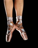 Foots with pointes. Of ballet dancer isolated on black Royalty Free Stock Photography