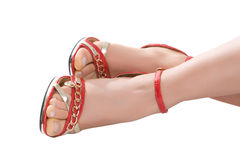 Foots in red sandals. Female foots in red sandals isolated on a white background Stock Photography