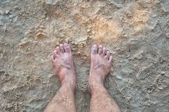 A foots. At the sand beach Stock Photography