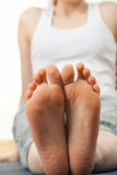 Foots of sitting woman Stock Photo
