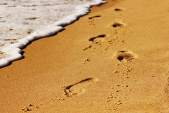 Footstep on beach. Footstep on the beach with waves Royalty Free Stock Photo