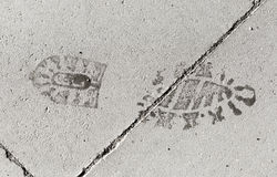 Footstep Imprint on Pavement. A Footstep Imprint on Pavement Stock Image