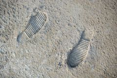 Footstep pattern on a concrete background Stock Images