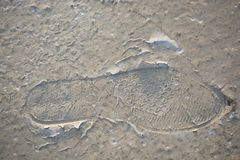Footstep pattern on a concrete background. Footstep pattern seen on a concrete background Stock Photo