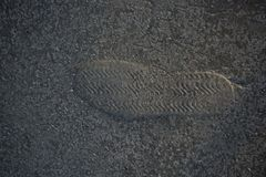 Footstep pattern on a concrete background. Footstep pattern seen on a concrete background Stock Image