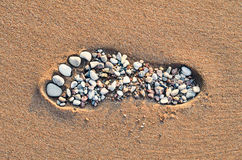 Footstep on sandy beach Royalty Free Stock Image