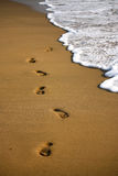 Footstep on the sandy indian beach. With foam of water Royalty Free Stock Photos