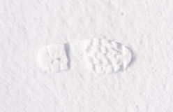 Footstep trails at snow by sunny day Stock Image