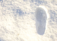 Footstep in the white Snow Stock Photo