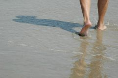 Footsteps. Walking along the surf in the ocean stock photo