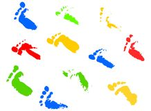 Footsteps. Different colorful children footprints on white Royalty Free Stock Image