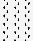 Footsteps of baby. On a gray background, seamless pattern Stock Photos