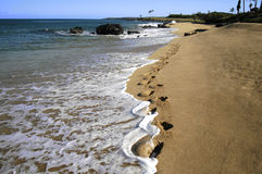 Footsteps On The Beach. Taken on the beautiful island of Molokai Hawaii where you can truly be the only one on the beach stock image