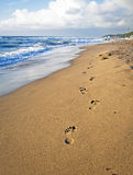 Footsteps on the Beach in Italy Stock Images
