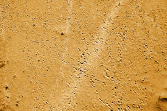 Footsteps in beach sand Stock Images
